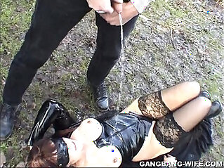 Dogging wife pissed on by guys in a park