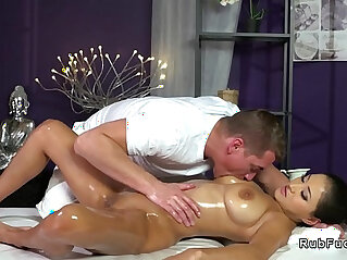 Brunette with natural tits and gets massage